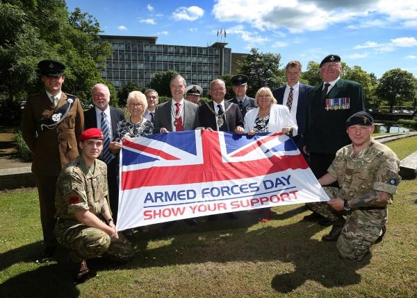 Cllr Jean Chaplow, Chairman's Consort; Professor John Anstee, Deputy Lieutenant for County Durham; Cllr Bill Kellett, Chairman of Durham County Council; and Cllr Lucy Hovvels, the council's Veterans Champion, with members of the armed and reserve forces.