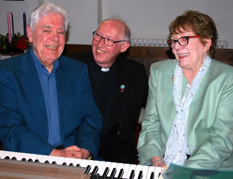 "Alex (left) was assisted by Doris Pearce (right) and was thanked by Upper Skerne Team Rector Father Michael Thompson (centre) who described the recital as ""truly wonderful""."