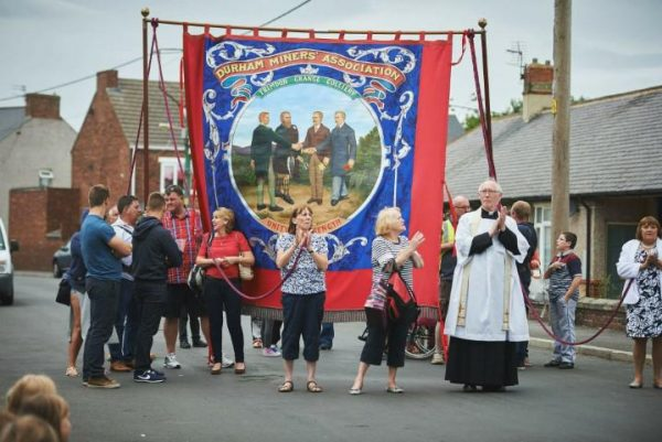 The Revd. Michael Thompson with a Trimdon banner