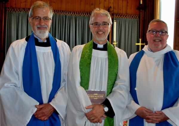 Area Dean Revd. Paul Neville (centre) with Michael King (left) and Bill Armstrong (right)