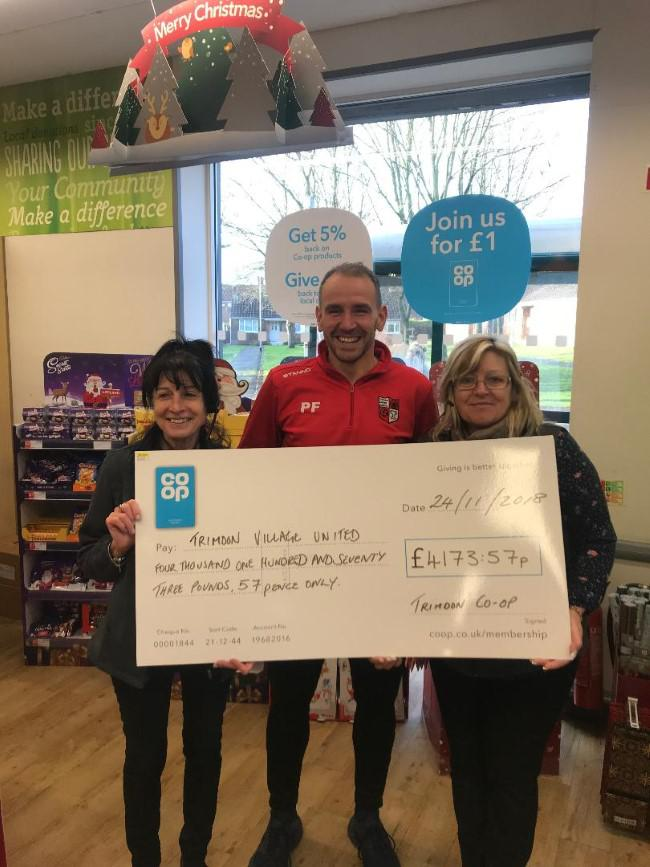 Phil Frampton on behalf of Trimdon United Juniors with Co-op's cheque