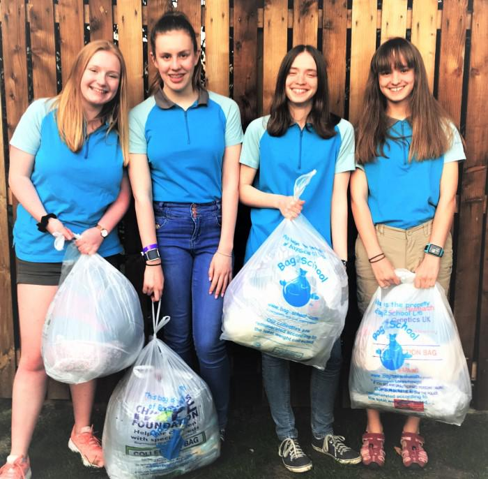 Kate Wallace (left) will do voluntary work in Sri Lanka, Jenny Walker (third left) in Bermuda, and Katelyn Craig (second left) and Abbie Walker (right) will take part in an international camp