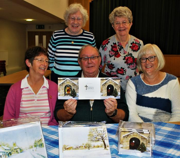 Brian Mutch, Membership Secretary of the Friends, is pictured showing the new trifold card to church members (l-r):  Judith King, Dorothy Ringer, Brenda Moore and Christine Mutch.