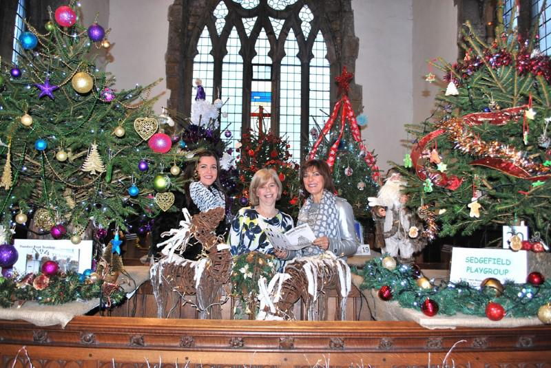 Popular television newscaster Pam Royal and daughter Pip with church member Julia Rowsby (centre) at a recent Tree festival